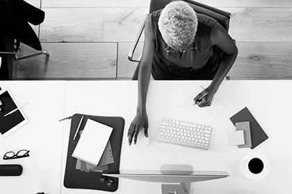 why do small businesses need a website header image - woman at desk